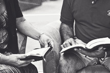 two men reading Bibles at a Bible study