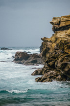 Rocky cliffs beside the ocean.