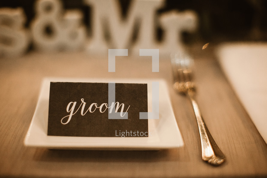 groom place card on a table