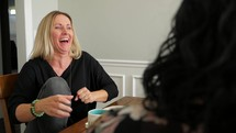 woman talking to a women's group Bible study sitting around a table