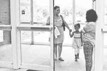 greeter welcoming a mother and daughter