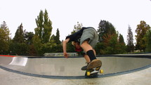 skateboarder doing tricks at a skate park