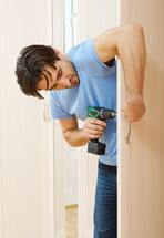A man using an electric drill