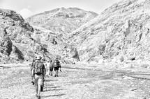 hiking through a desert canyon