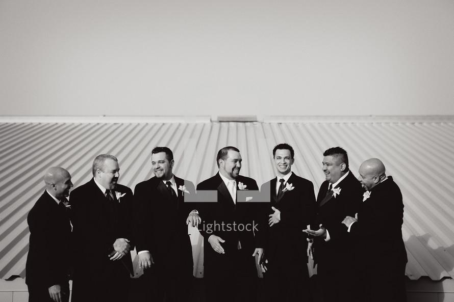 groomsmen talking