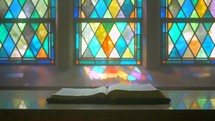 old chapel bible on an altar stained glass dolly-zoom wide angle
