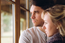 couple looking out a window