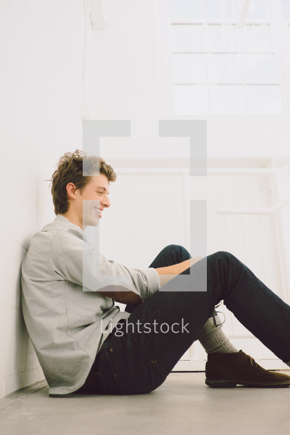smiling face of a young man sitting
