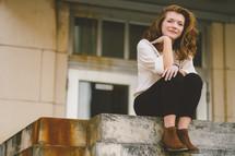 woman sitting on a  ledge