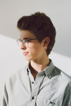 side profile of a young man in glasses