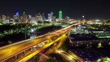 Timelapse of downtown Dallas traffic at night.