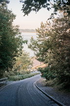 curving cobblestone road along a shore