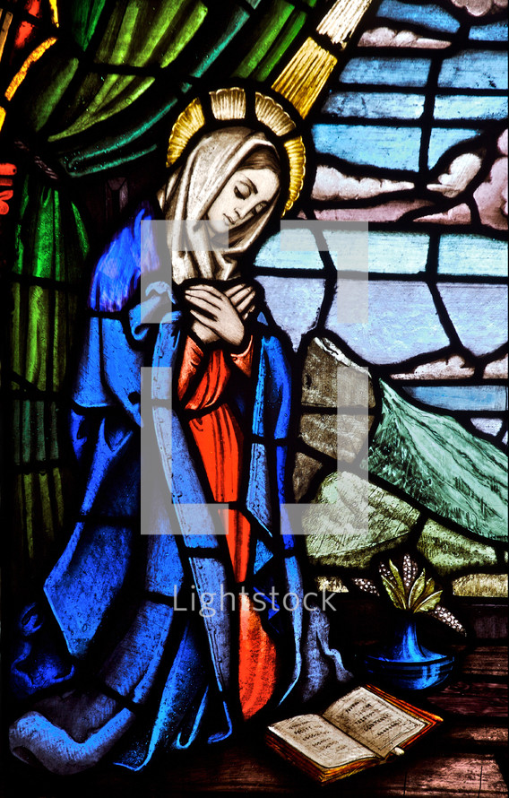 stained glass window of Mary at the annunciation of our Lord