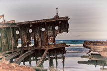 corroded rusty boat on a shore