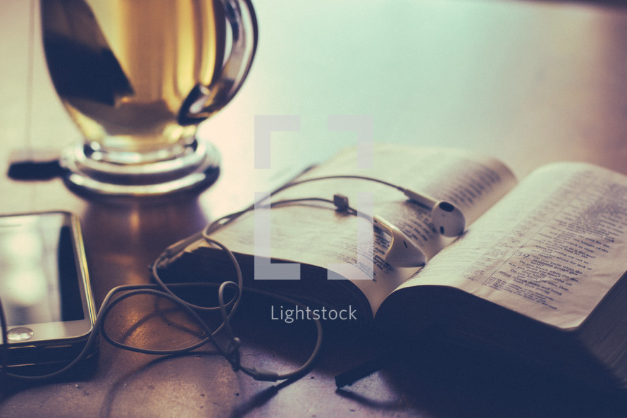 iphone, ear buds, Bible, tea mug