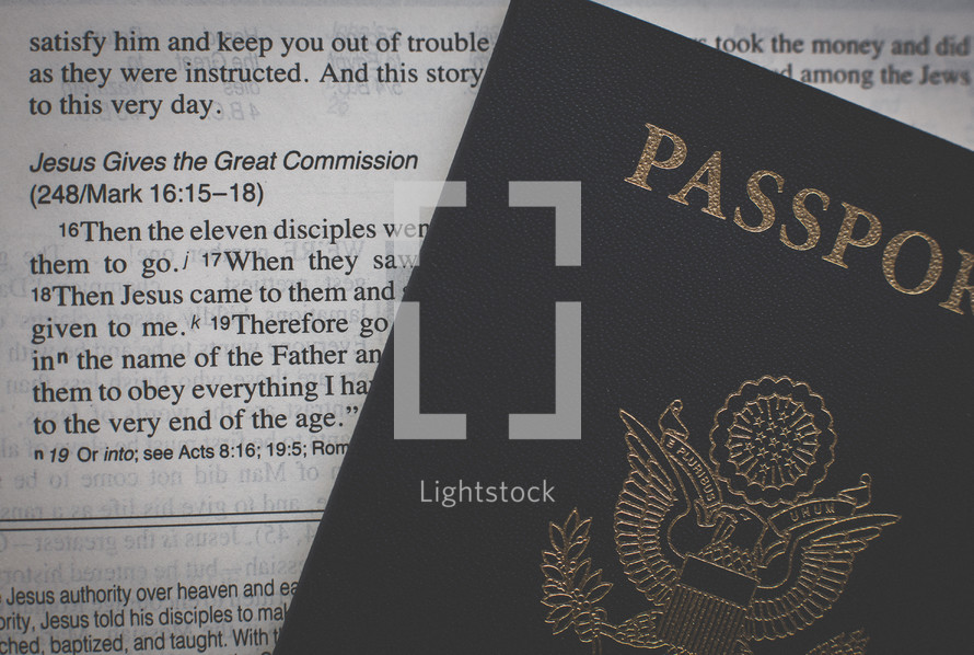 Passport on the pages of a Bible