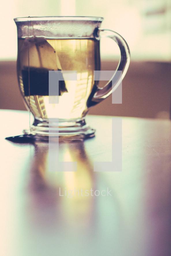 brewing tea in clear mug