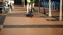 riding a bike on a boardwalk
