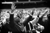 hands raised in worship and praise to God at a worship service