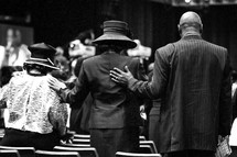man and women in prayer at a worship service