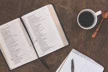 open Bible, notepad, pen, Bible study, coffee mug, spoon