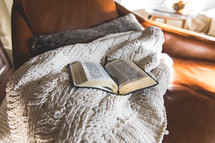 open Bible on a blanket in a chair