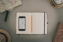 map, personal speaker, cellphone, journal, border