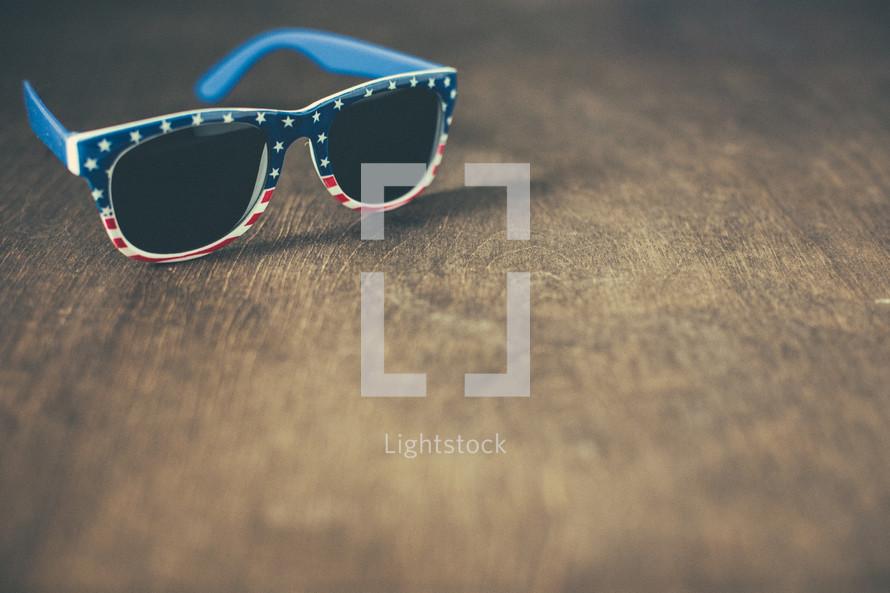 patriotic sunglasses on wood background