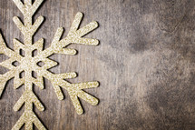 snowflake ornament on a wood background