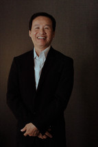 smiling Asian man posing for a portrait