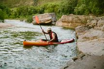 man paddling in a kayak