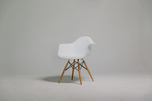 An empty chair in a bare room.
