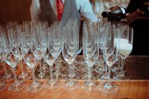 wine glasses at a wedding reception bar