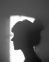silhouette of a woman's side profile