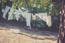 clothes drying on a clothesline and a laundry basket