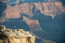 man looking out at a canyon