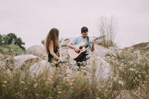a man serenading a woman