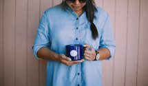 a woman holding a coffee mug