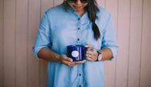 a woman holding a coffee mug