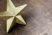star ornament on a wood background