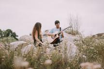 a man serenading a woman outdoors