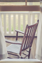 wood rocking chair on a front porch