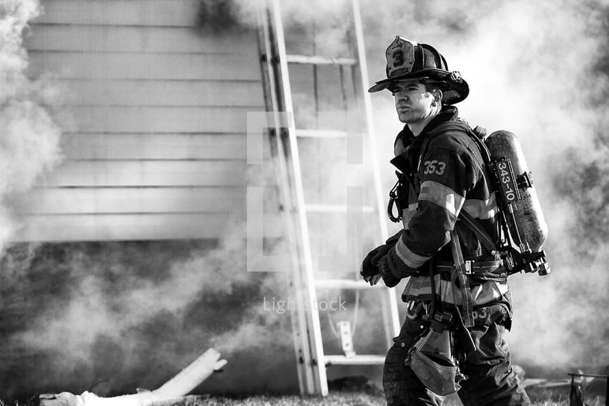 Fireman in a cloud of smoke.