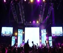 teens jumping and dancing at a concert