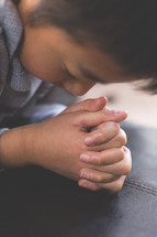 A boy child in prayer