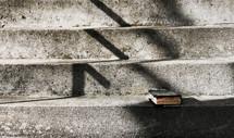 a Bible on concrete steps