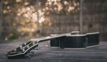 guitar on a wood table outdoors