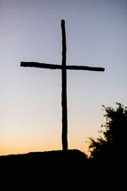 Silhouette of a cross at dusk.