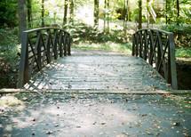 wood footbridge on a nature trail