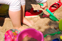 kids playing in the sand with sand toys